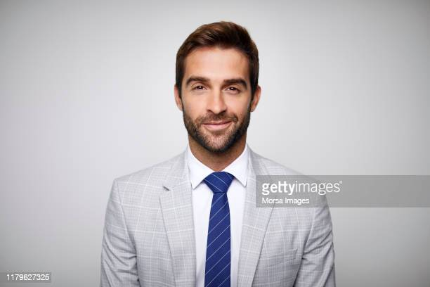 confident handsome businessman wearing gray suit - anzug stock-fotos und bilder
