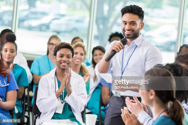 Confident healthcare professionals attend continuing education class