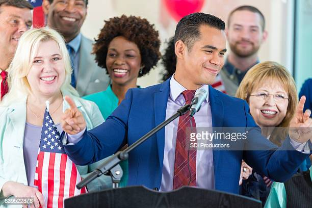 Confident Hispanic politician addresses supporters