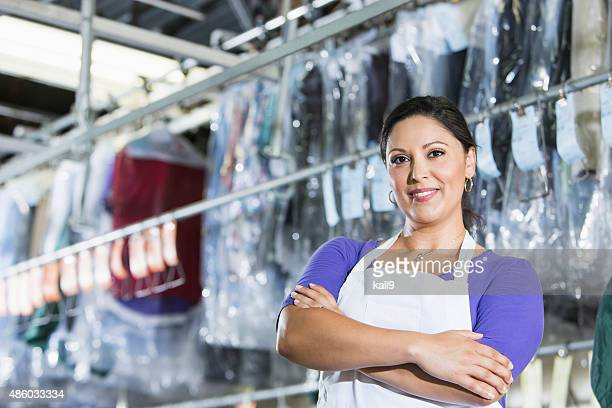 confident hispanic woman in her dry cleaning store - dry cleaner stock pictures, royalty-free photos & images