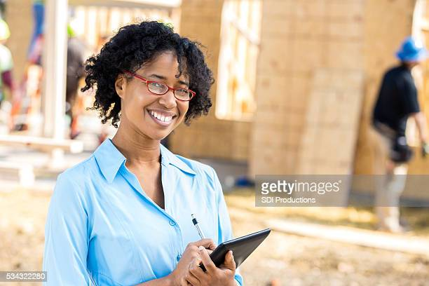 Confident home builder at job site