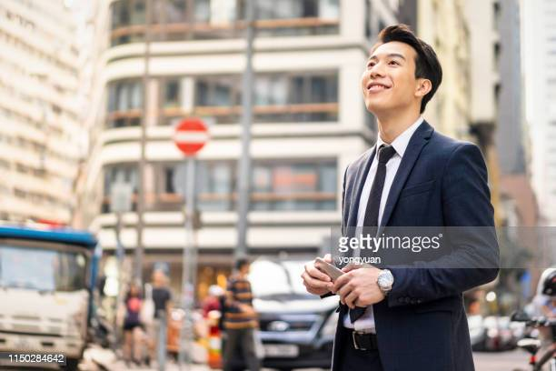 confident hong kong businessman - handsome chinese men stock pictures, royalty-free photos & images