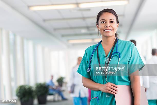 Confident hospital nurse smiling while working in modern hospital