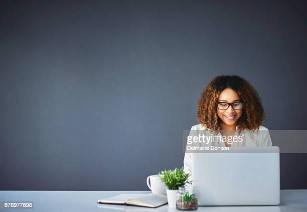 confident in her abilities - person on laptop stock pictures, royalty-free photos & images