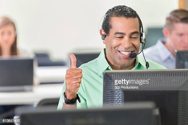 Confident IT support person assists customer
