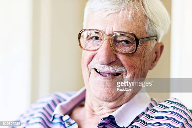 Confident, laughing, 90-year-old man in spectacles