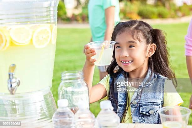 Confident little girl sells lemonade