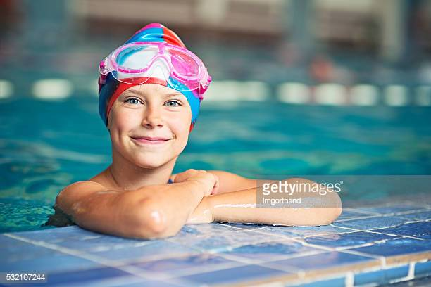 Confident little swimmer in swimming pool