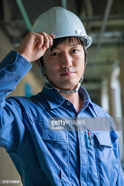 Confident looking engineer or inspector at a building construction site