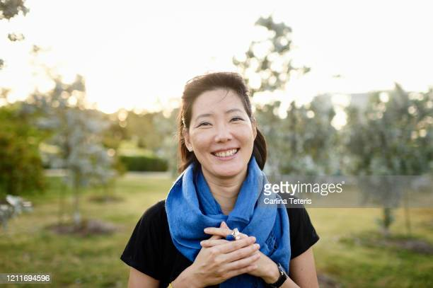 confident malaysian woman in a park - asia stock pictures, royalty-free photos & images