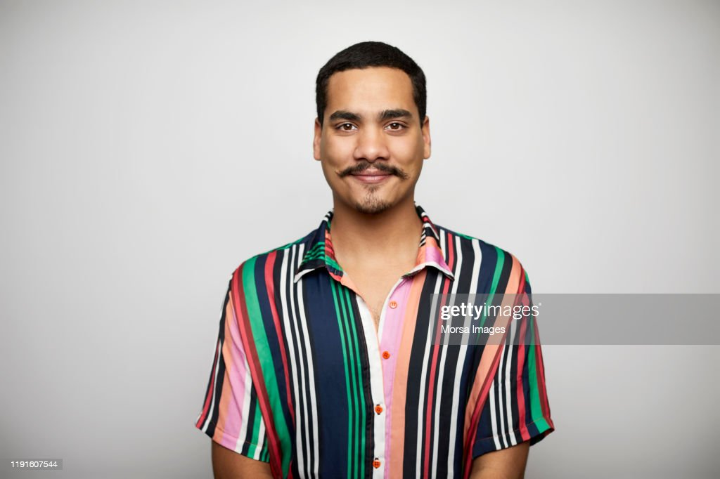 Confident male against white background : Stock Photo