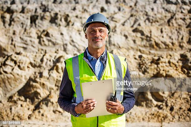 Confident male architect standing at quarry