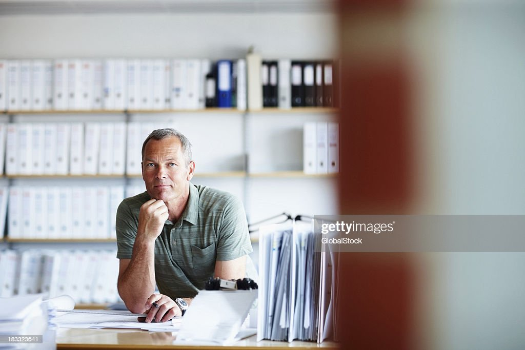 Confident male architect working on a new project : Stock Photo