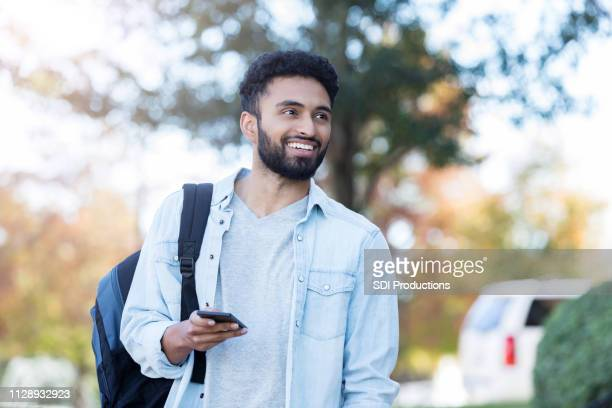confident male college student on campus - college students stock pictures, royalty-free photos & images