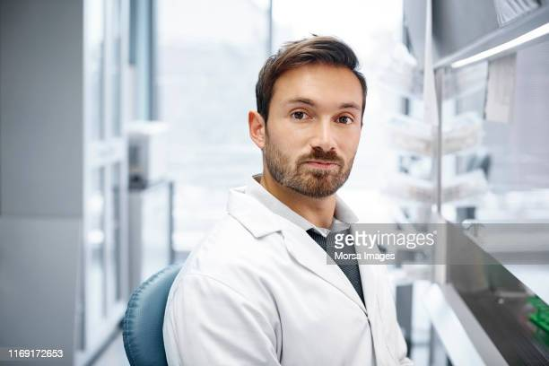 confident male doctor at research center - stubble stock pictures, royalty-free photos & images