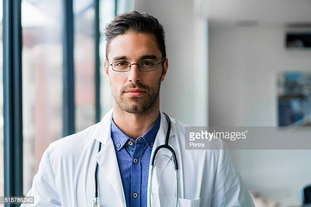 Confident male doctor in hospital