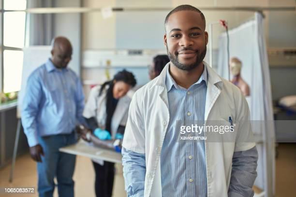 confident male medical student in training class - medical student stock pictures, royalty-free photos & images