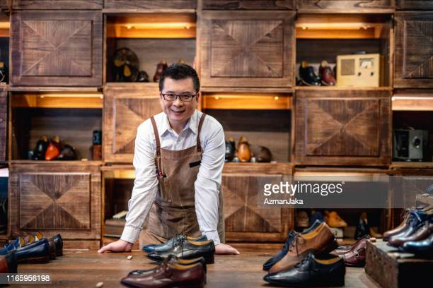 confident male taiwanese shoe store owner - leather shoe stock pictures, royalty-free photos & images