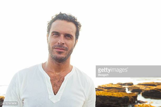 confident man in 30s enjoys happy beach lifestyle bali indonesia - hairy chest stock photos and pictures