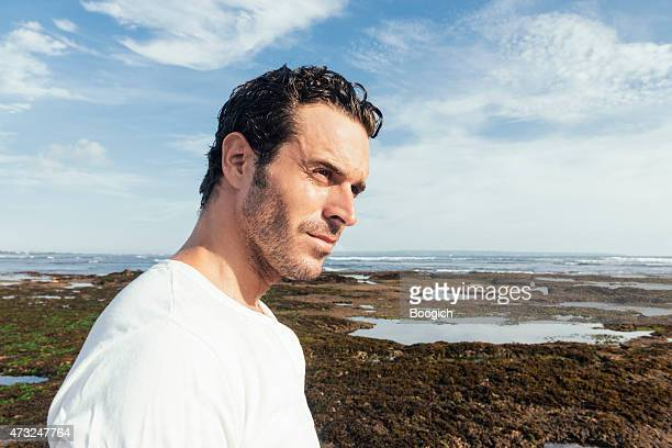 confident man in 30s enjoys scenic beach bali travel destinations - muscle men at beach stock photos and pictures