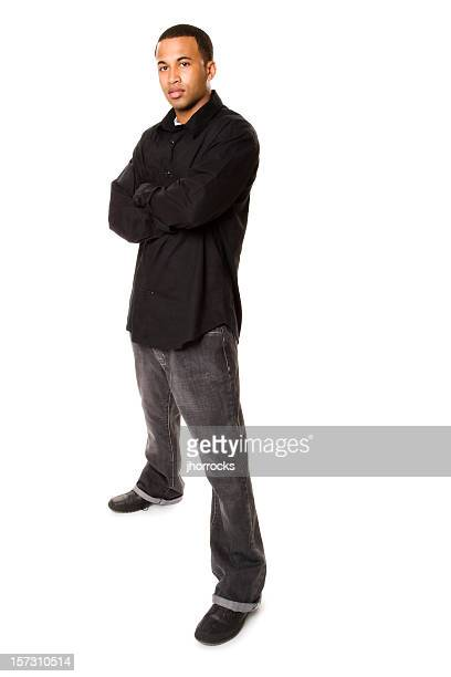 confident man in black - legs apart stock pictures, royalty-free photos & images