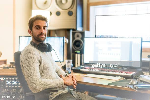 confident man in sound recording studio - recording studio stock pictures, royalty-free photos & images