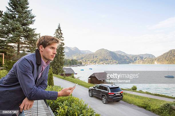 Confident man overviewing lake