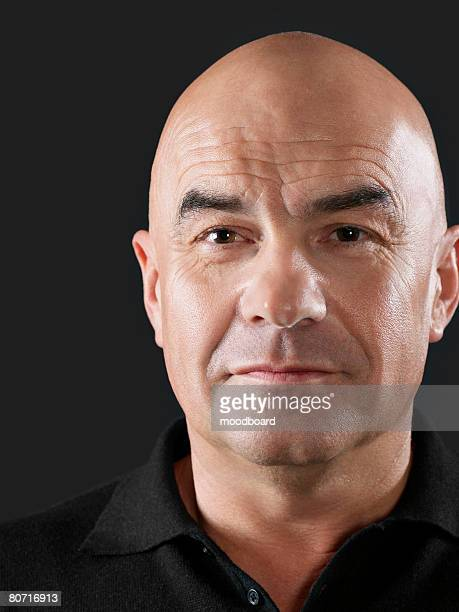 confident man - completely bald stock photos and pictures