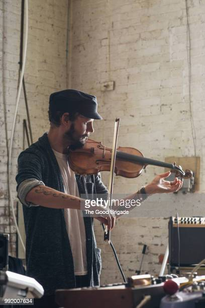 Confident Man Playing Violin