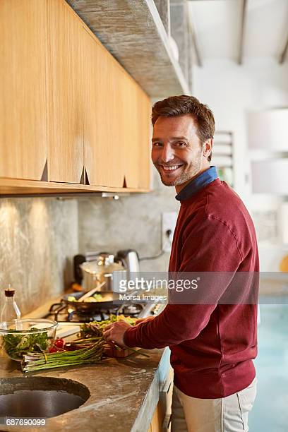 confident man preparing food at counter - one mature man only stock pictures, royalty-free photos & images