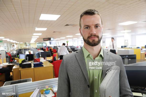 Confident man stood in office