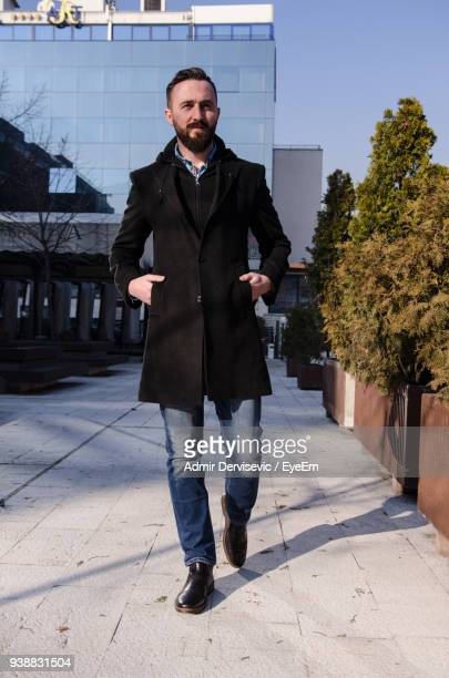 Confident Man Wearing Black Jacket In City
