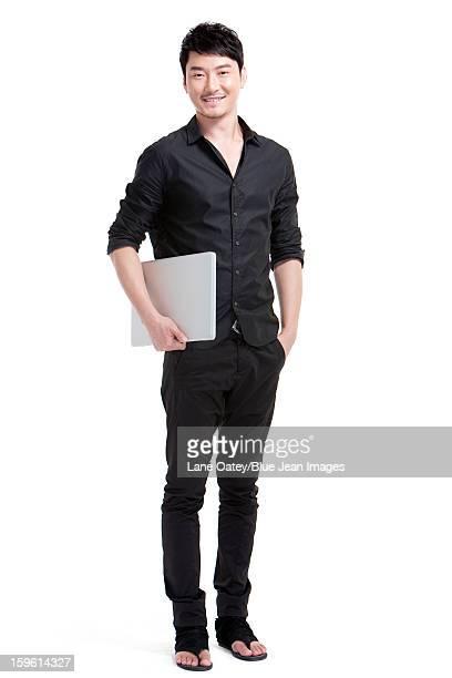 Confident  man with laptop