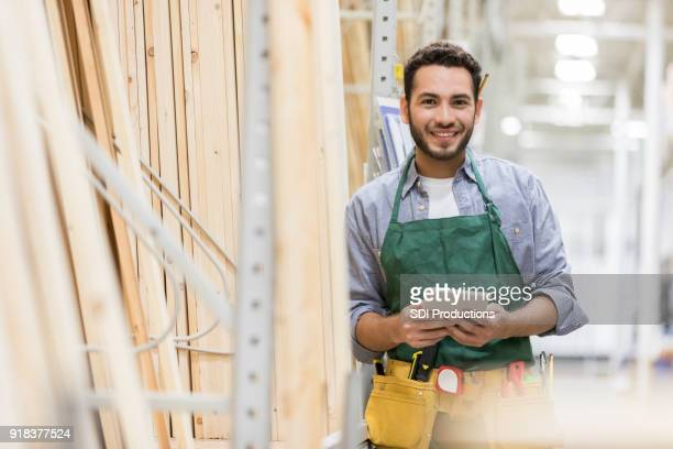 Confident man working in lumber yard