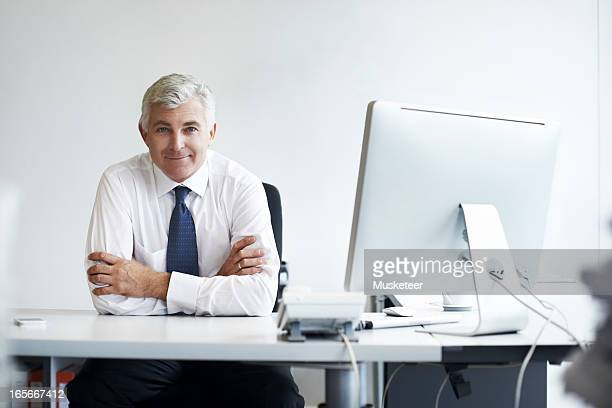 Confident manager at his desk