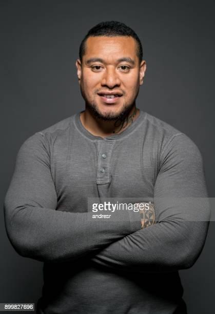 confident maori man in a studio - polynesian culture stock photos and pictures