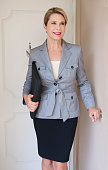 attractive confident mature business woman standing
