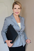 confident attractive mature business woman standing