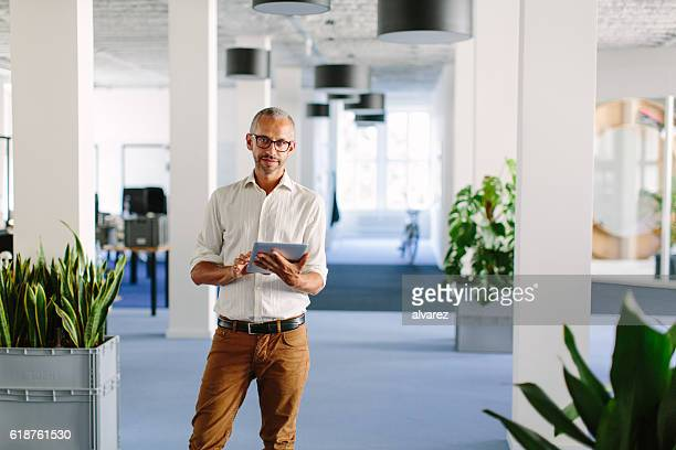 Confident mature businessman at startup