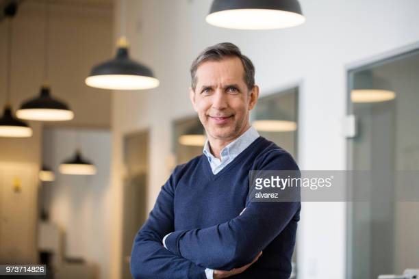 confident mature businessman in office - man in office stock photos and pictures