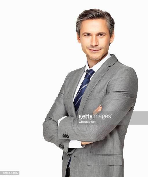 confident mature businessman with his arms folded - grey suit stock pictures, royalty-free photos & images