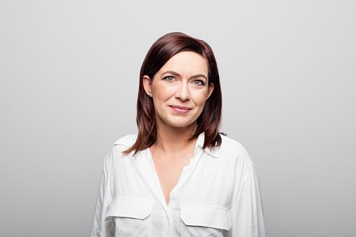 Confident mature businesswoman on white background 1132314350