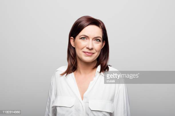confident mature businesswoman on white background - medium length hair stock pictures, royalty-free photos & images