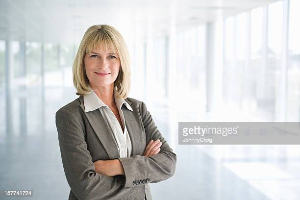 Confident Mature Businesswoman With Arms Crossed