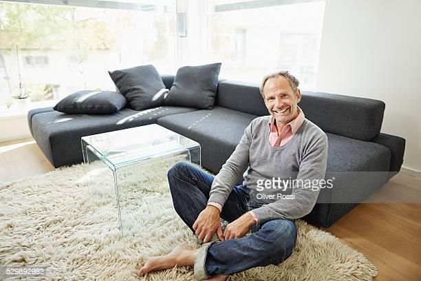 Confident mature man in living room