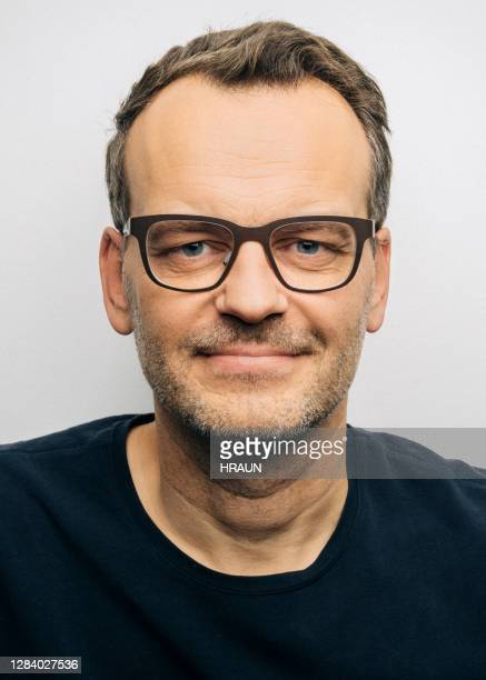 confident mature man wearing eyeglasses - police mugshot stock pictures, royalty-free photos & images
