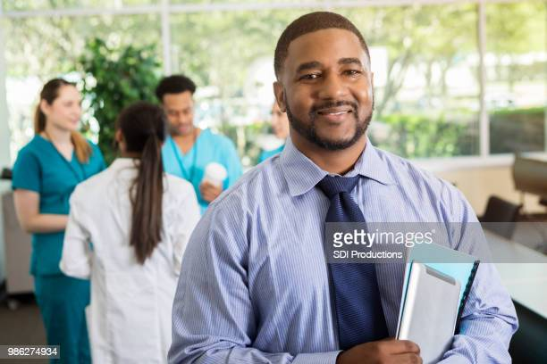 confident mid adult doctor at medical conference - participant stock pictures, royalty-free photos & images