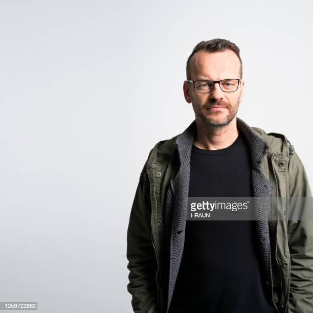 confident mid age man posing in studio - creative director stock pictures, royalty-free photos & images