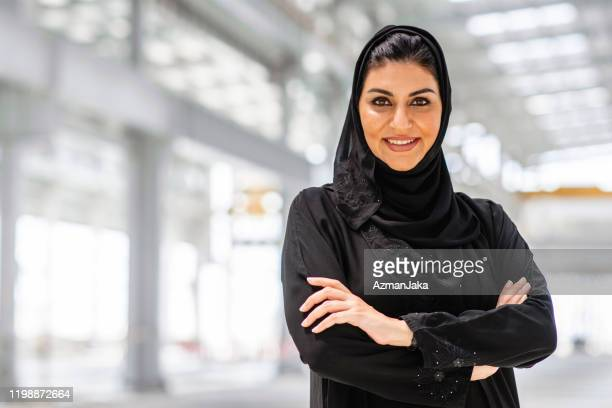 confident middle eastern female construction professional - united arab emirates stock pictures, royalty-free photos & images