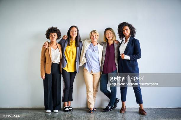 confident multi-ethnic businesswomen at office - group of people stock pictures, royalty-free photos & images
